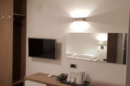 SMS Studios  Luxury triple room