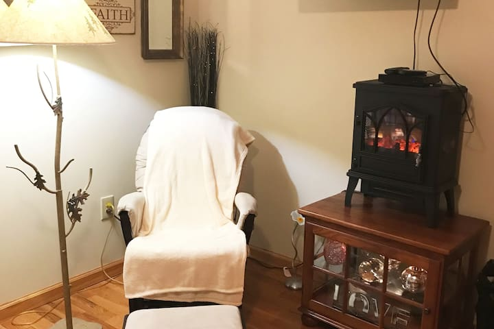 Master has a sitting/reading area. Electric fireplace is great for ambience but will run you out of the room if you se the heat feature. The stand the fireplace sits on also lights up for a warming atmosphere.