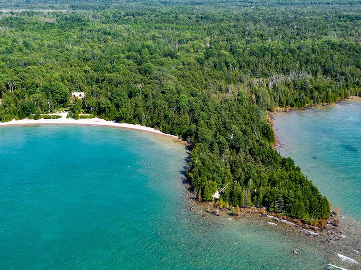 Secluded private 1200' beachfront Log home.