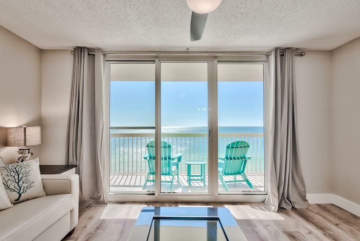 Living room with unobstructed gulf and beach views