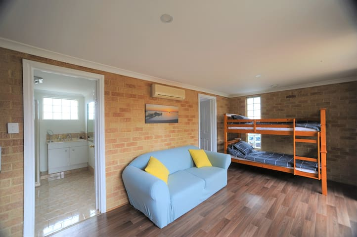 Adorable granny flat shower room and bunk beds