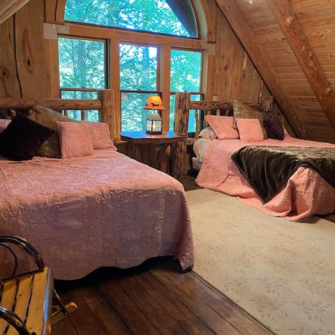Two queen beds upstairs in the loft with an internet TV and stellar views