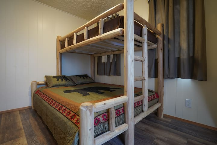 Guest Bedroom with queen and twin xl mattress bunkbed.