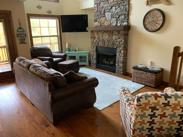 Open floor plan makes for great entertainment space with a cozy fireplace, 48 inch tv, books, games, and much more!