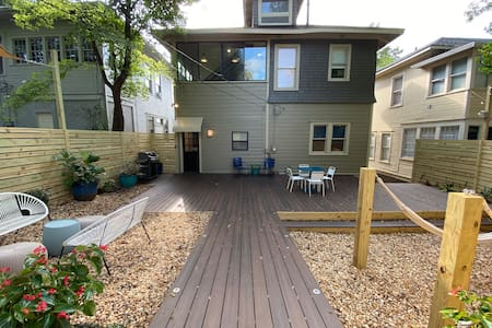 The rear entrance to the house is step-less. There is a ramp leading from the parking pad to the main deck and a small ramp leading up to the rear door. From the rear door, guests can enter the back of apt 1 without steps.