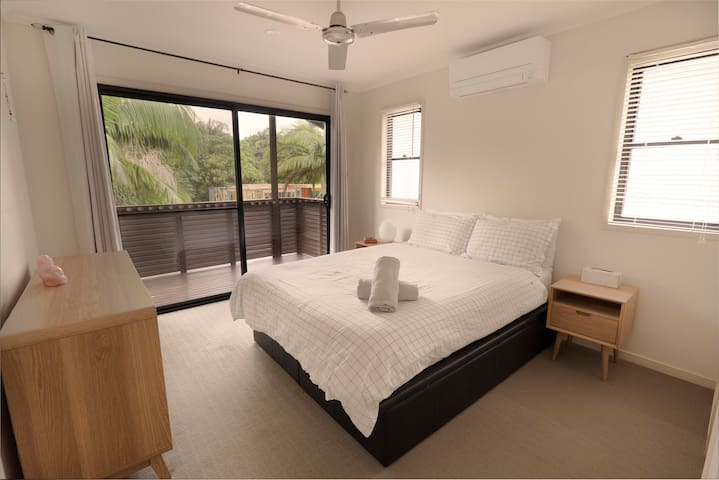 Master bedroom - Queen  Bed, Air conditioned, ceiling fan plus chest of drawer and side tables for storage