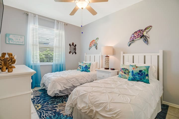 The beautifu 3rd guest room is a spacious twin with TV and ample closet space. The beds are also easy to push together for a more intimate sleeping arrangement.