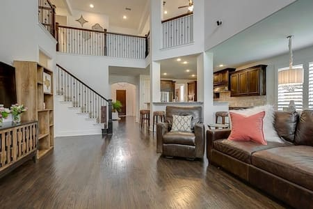 View of the front entrance and stairs from the downstairs living room.