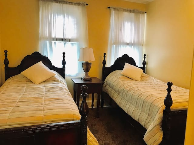 Bedroom upstairs with twin Beds