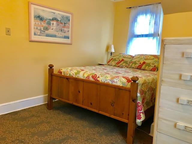 Queen sized bed upstairs bedroom
