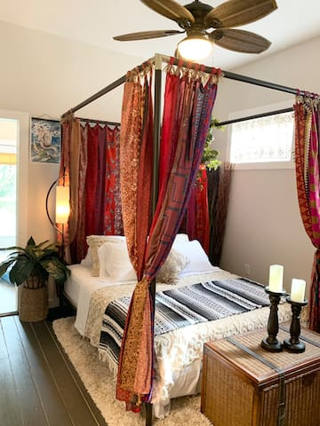 Bedroom: extra tall, queen canopy bed, quiet ceiling fan, & closet (faux interior plants only).