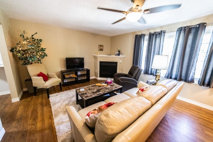 """Comfy living room with 55"""" tv, Start.tv premium channel package and Chromecast device."""