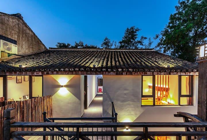 西塘亦心民宿景区内可接送三室一厅三卫麻将投影套房