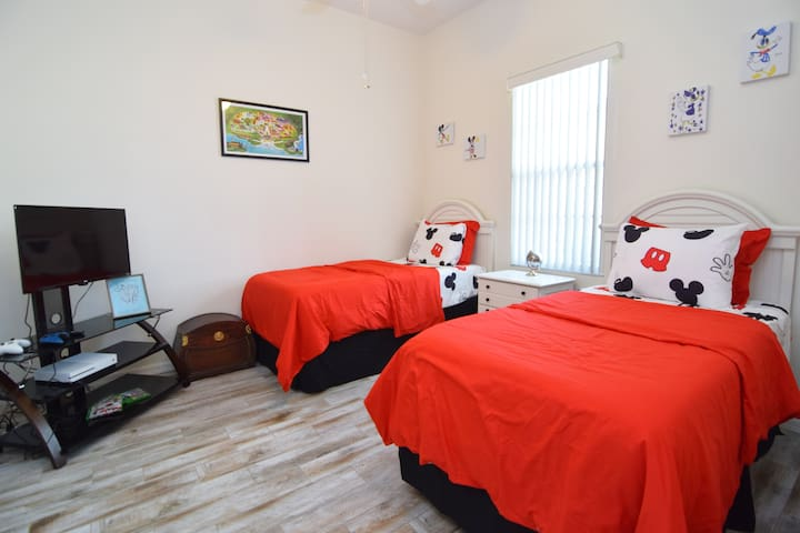 Fun Disney twin room - the perfect kids' hang out! Twin beds, bean bags, flat screen SMART TV, XBox One console, ceiling fan