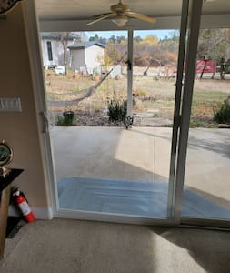 "Sliding glass door opens to a 43"" clear access."