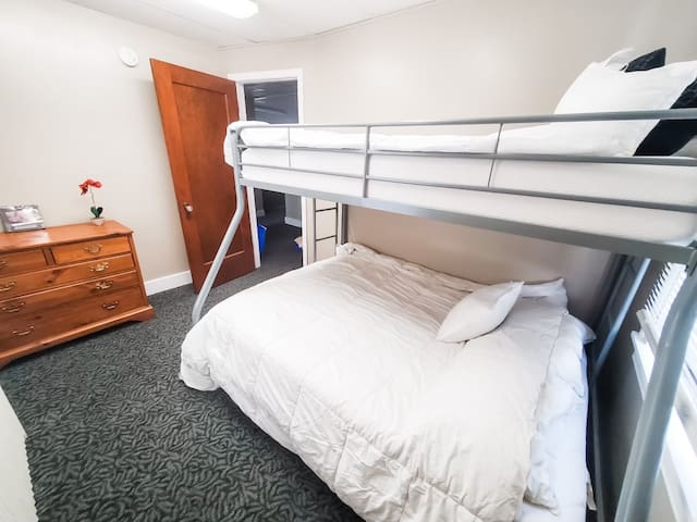 Main floor Bedroom with full bed and twin bunk beds