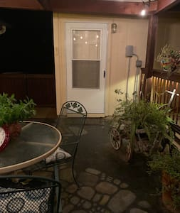 When you enter main house back patio this door is just to the left.  There is one step up to patio.  Door will be open and owner will give you code to lock door when gone