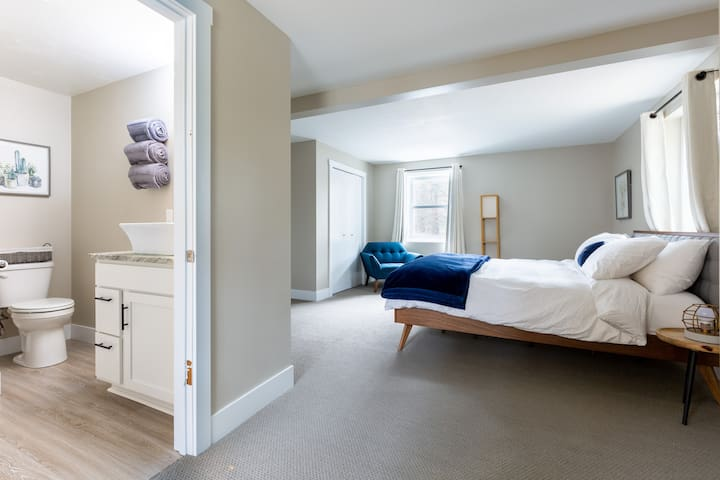 Master suite (sleeps up to 2): 1 king bed with luxury hotel bedding, 2 night stands, a deep seat armchair, blackout curtains, a full bath with stand up shower