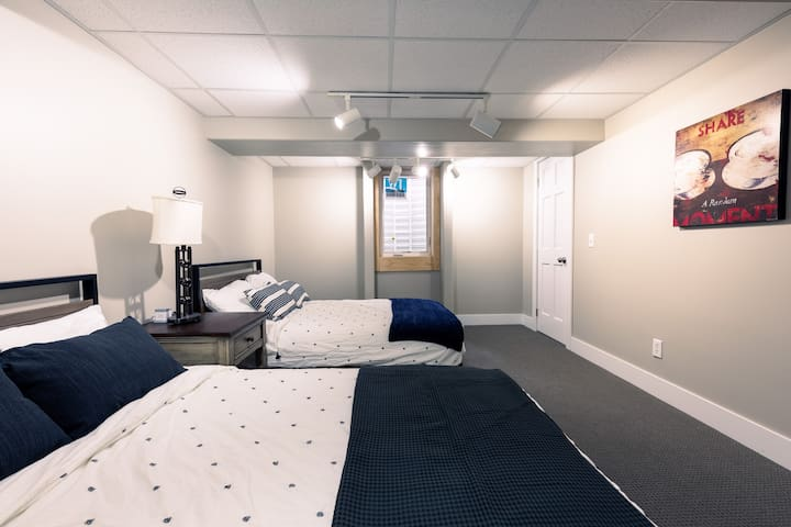 The 4th bedroom with 2 full beds in the basement with an oversized Egress window.