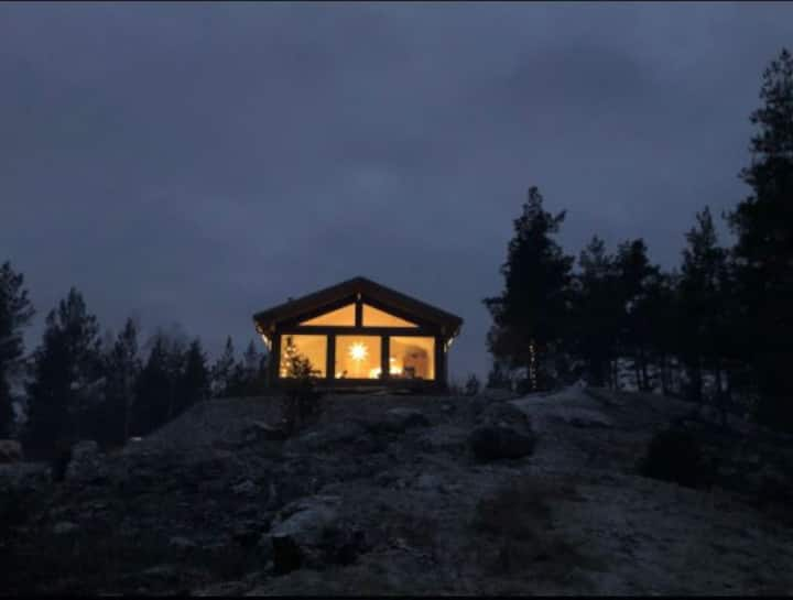 Modern Cabin with lake view in the woods