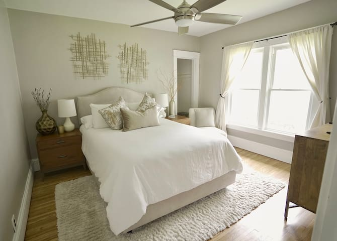 """Master Bedroom with queen bed, pillow top mattress, mattress protector, Tempur-pedic pillows, 50"""" tv, ceiling fan and sound machine if needed"""