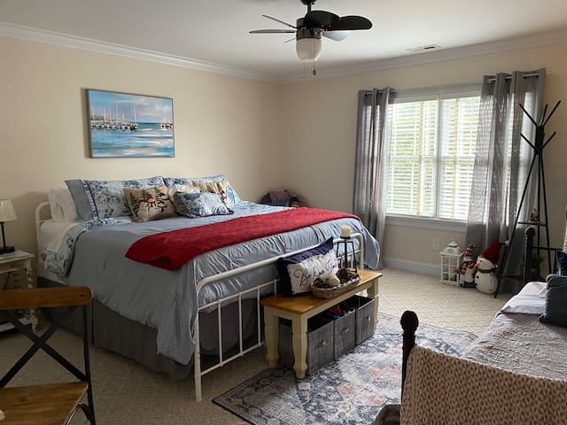 Comfortable King Bed with Single Day bed and vanity with chair. Closet has 2 air mattresses, a portable crib and extra blankets.