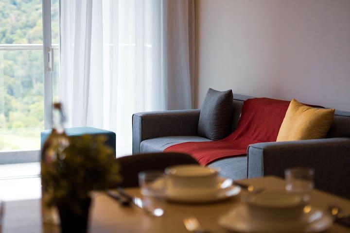 Sofa beside Balcony with greenery view.