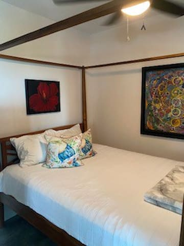 Queen size Sealy Dorado Luxury Pillow top mattress on a 4-poster teak bed.  A beautiful nights sleep can be yours!   Original artwork from local Puerto Rican Artists.