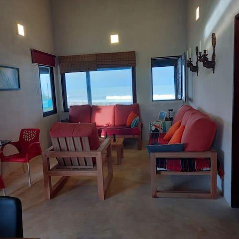 Sala de uso comum com vista para o mar com 2 sofás-cama