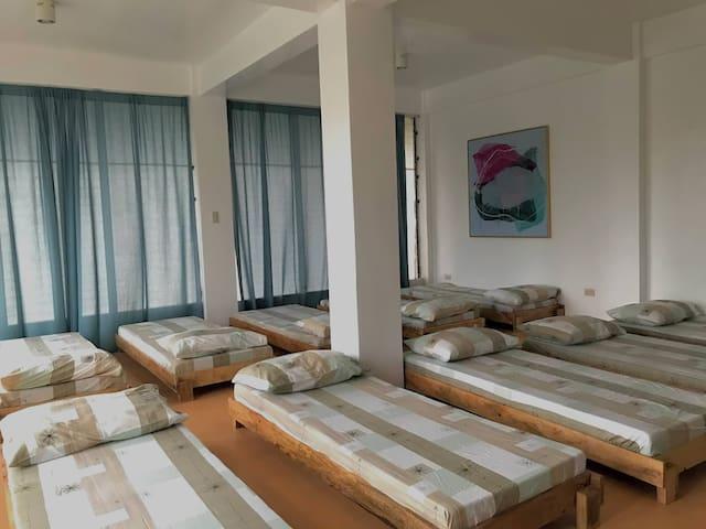 Common sleeping area on upper floor sleeps up to 10 guests