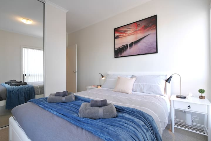 Comfortable second queen bedroom. Large mirrored robes for all your clothes. Lots of natural light for some nice warm sun. Perfect for a longer term stay.