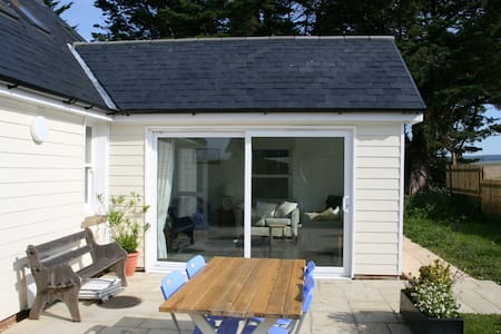 Sliding patio doors for wheelchair access, well back from outside dining table