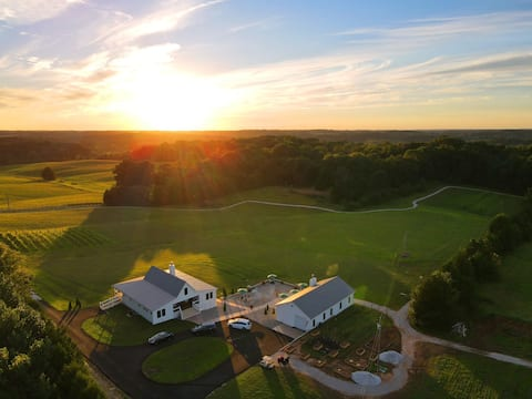 Modern Farmhouse Villa Overlooks Vineyard by Lake