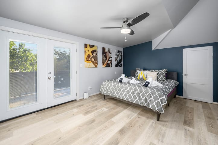 Master bed room with entry to patio with King bed