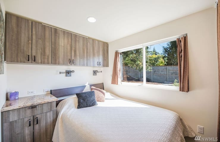 Bedroom with queen bed and storage
