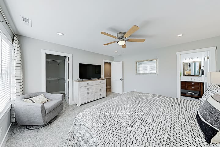 """Master Bedroom - Keep up with your favorite programs on the 55"""" cable TV in the master."""