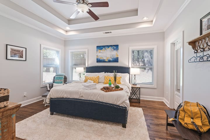 The Master bedroom has plenty of natural light, a king size bed and bedside charging station to rest in peace.