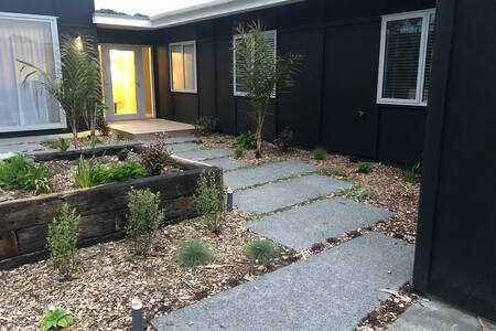 Front entrance from driveway. Easy access only one large wooden landing with stair. For no stairs the alternative option is to walk around side house to back door which has large stacking slider doors level with patio