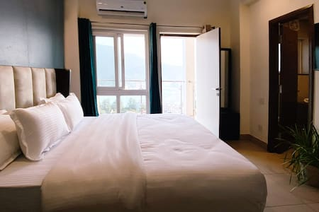 Deluxe Room with Balcony at Founders Home