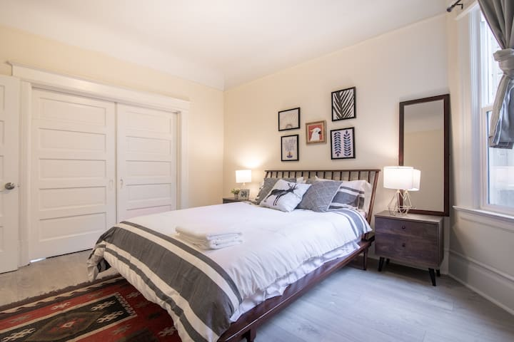 Queen Bedroom #1, with comfy Memory Foam mattress, lovely high thread count sheets, lots of pillows, and a cozy rug.
