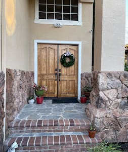 This is a photo to the entrance. There are 2 steps up to the front door. There is motion light and camera on right top of the door.