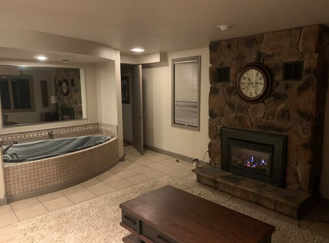 Second Bedroom/ additional living room - Sofa pulls into a queen bed.  Heart shape jacuzzi -  It is a walk through and also very private!