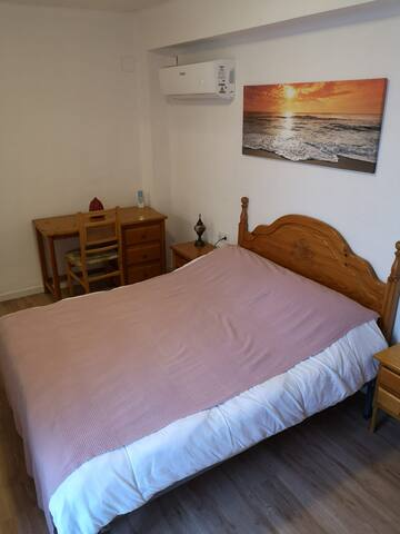 Master bedroom, desk to write postcards about your Valencia discoveries. Update your social media in peace and cool