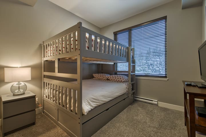 Bedroom #2- with double over double bunk beds + a single trundle