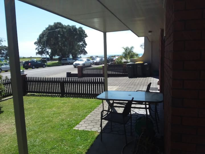 Beach front, next to surf club, shops and cafes