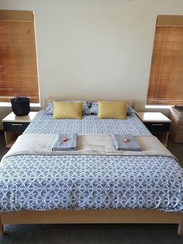 Bedroom 1, Queen bed, sea view, private balcony.