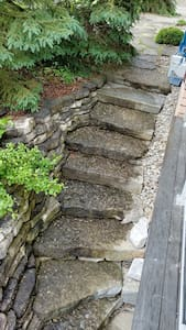 Stone stairs at the southside of the house to access the private entrance under the balcony.