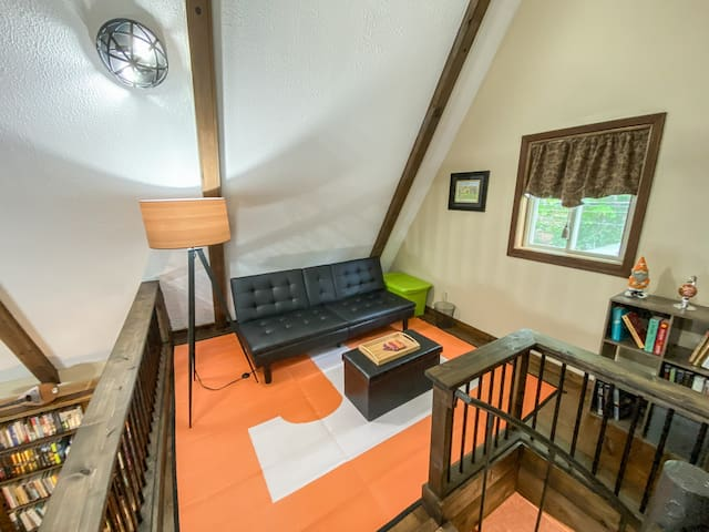 The loft above the living room has a click-clack futon and can serve as a 4th open-air bedroom.