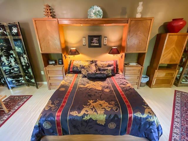 Queen bed in bedroom 2.