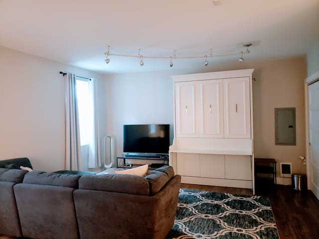 Lounge serves as a suite with ensuite half bath.  Work/study at the desk or sit back and enjoy a movie